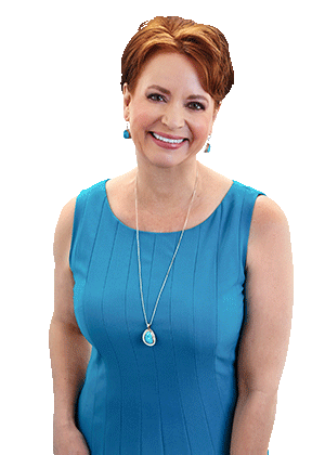Deborah Elliott-Schultz in a blue dress, smiling
