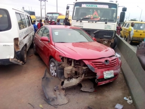 Multiple Accident Involving A Car, Tipper And School Bus At Abule Egba, Lagos