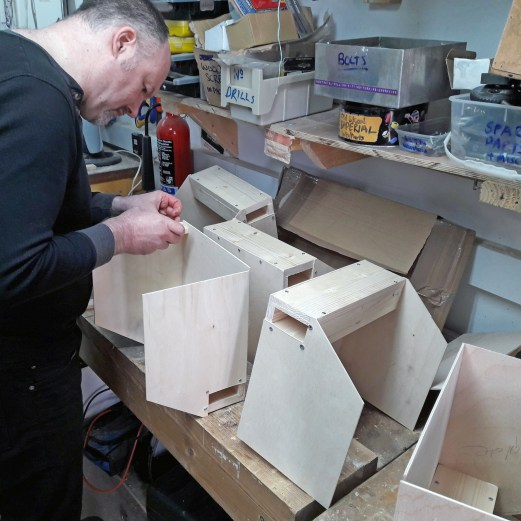 Simon assembling boxes