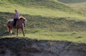 girl riding along cliff