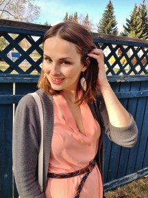 coral feather earrings, coral silk blouse, braided leather belt
