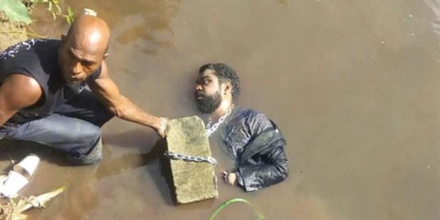 El cadáver de Yuniol Ramirez Ferreras es sacado del agua