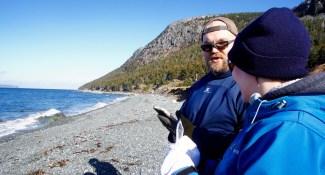Volunteers using the Marine Debris Tracker app.