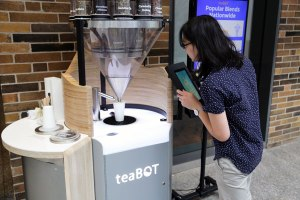 Sarah Lim (Year 3 MechE) inspects a teaBOT. (Photo: Tyler Irving)