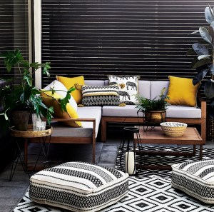 Balcony with Patterned Rugs and Plush Cushions