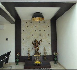 Tile backdrop with brass statue