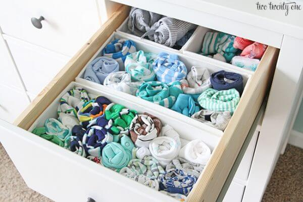 Roll t-shirts pajamas and workout clothes into storage box