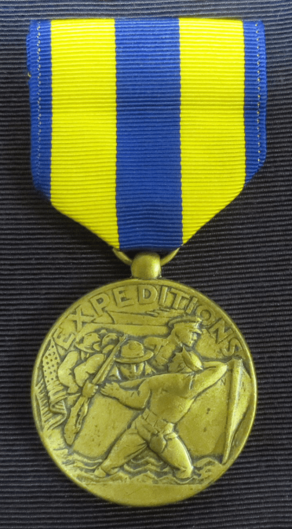 Gold medal with yellow and blue ribbon