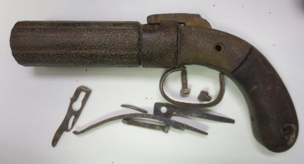 Rusty revolver with its parts