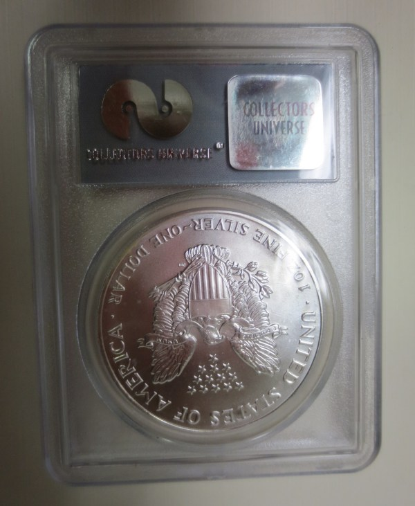 Coin place in a transparent holder