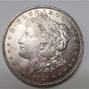 Close up photo of coin containing the face of liberty in side view