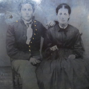 Black and white photo of a man and woman sitting beside together