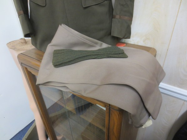 Folded trouser with some army green cloth