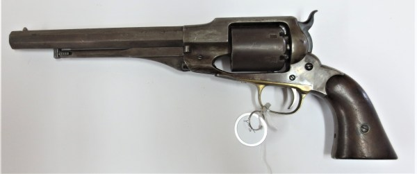revolver with a white tag attached