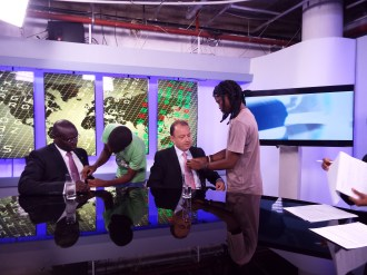 Advisory for Francophone Africa, Thierry Colatrella, getting prepped to go on air.