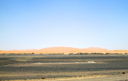 The dunes of Erg Chebbi loom and beckon from the distance.