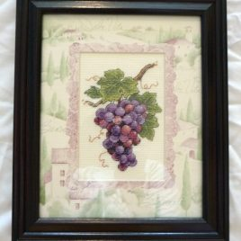 Cross-stitched framed and matted Grapes