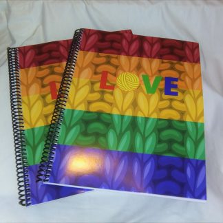 Image of spiral knitting planner in rainbow colors with the word LOVE printed on front with white background