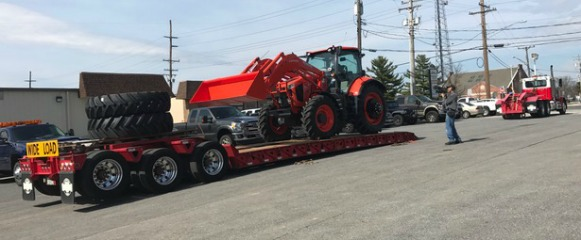 Photo of tractor on truck