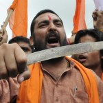 HOPAL, INDIA - AUGUST 11: Bajrang Dal workers stage a protest against incidents of attack on Hindus those happened in Kishtwar, Jammu on August 11, 2013 in Bhopal, India. A town in the south of Indian Kashmir was under curfew for a second day after two people were killed and dozens wounded in Hindu-Muslim clashes in the disputed Himalayan region, police said. Stores and buildings were torched in the clashes on August 9, which erupted in Kishtwar town, 150 kilometres (90 miles) southeast of Kashmir's summer capital Srinagar after prayers marking the end of Ramadan. (Photo by Gagan Nayar/Hindustan Times via Getty Images)