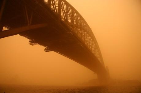 Sydney Harbour Bridge, blanketed by red haze