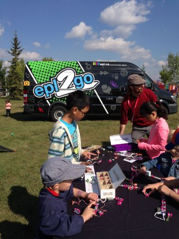 Edmonton Public Library -Kids explore Little Bits and other maker equipment at an outdoor community event
