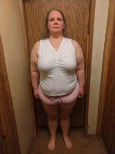 progress photo of Sarah standing in front of door