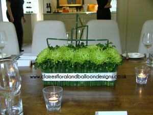 Modern chrysanthemum and snake grass table arrangement