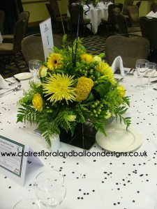 Yellow and black themed floral corporate table centrepiece