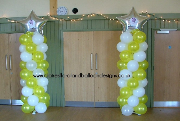 Balloon columns with foil star toppers