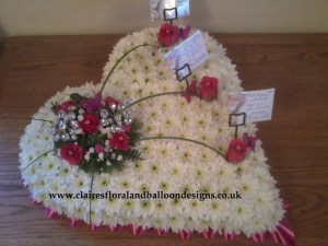 Funeral flowers based heart with butterflies