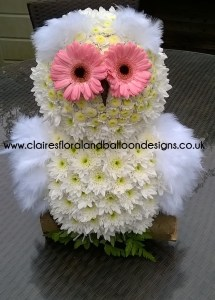 Floral owl funeral tribute