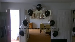 Black and silver latex doorway balloon arch