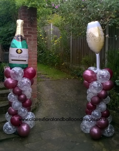 Champagne themed balloon entrance columns