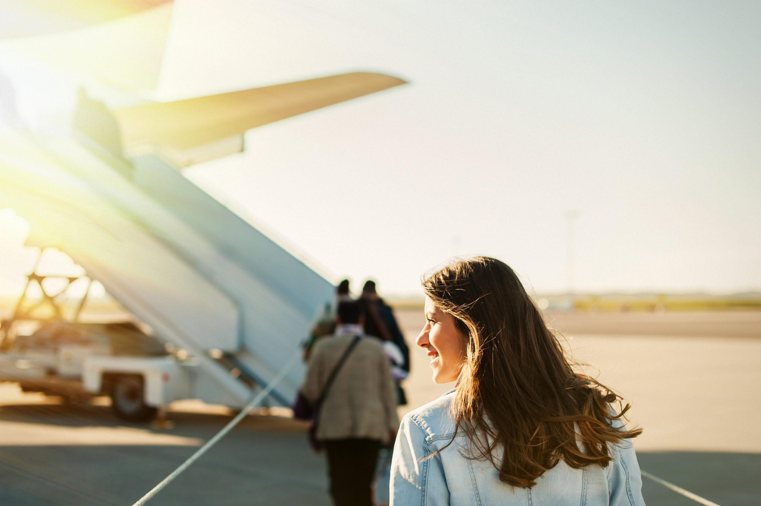 woman boarding a plane
