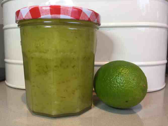 Jar of Lime Curd with a fresh whole lime.