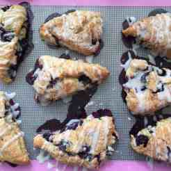 8 triangle portioned blueberry scones drizzled with Lemon icing.