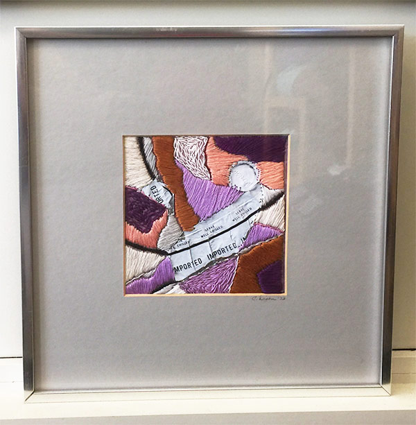 FRAME TEXTILE ART BEHIND GLASS