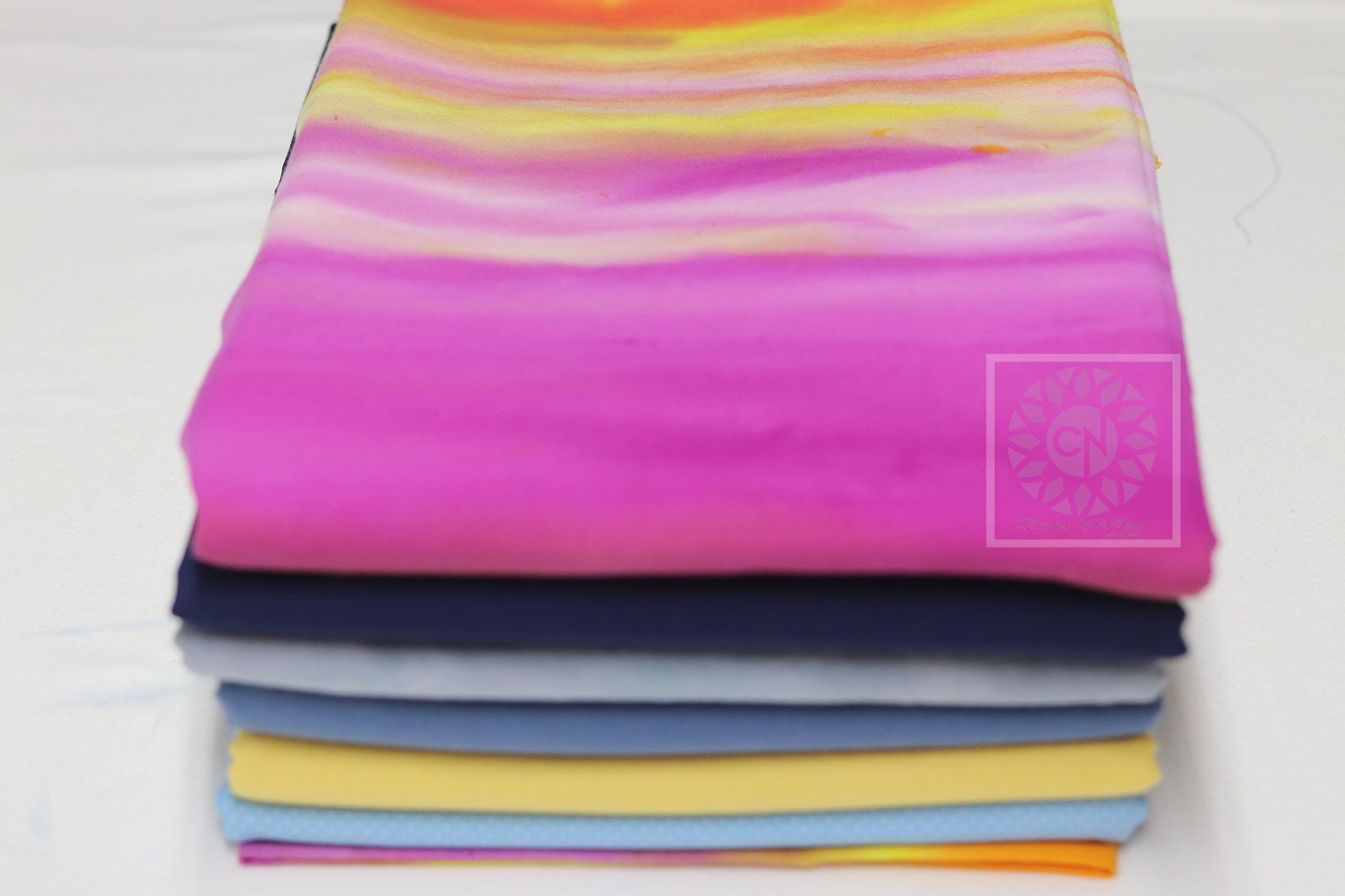 Organize your creative space and learn to easily fold your fabrics neatly