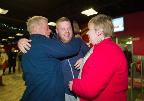 Liam Reale of Doon is greeted by his mother Pauline and dad Willie, on his arrival home for Christmas at Shannon airport. Photograph by John Kelly.