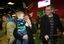 Eileen Daly of Ennis greeting her little grandson William and her son John Daly as they arrive home for Christmas at Shannon airport. Photograph by John Kelly.