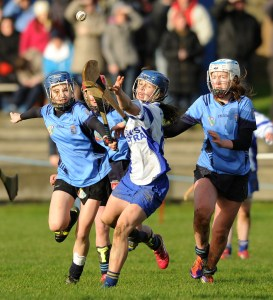 Aoife Keane of St Flannan's in action against Eimear O Gorman and Meadhbh Buckley of St Mary's Charleville during their Munster Senior A Colleges Camogie championship final at Newmarket. Photograph by John Kelly.