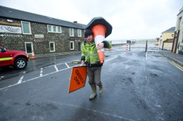 A workman at the site of the storm damage at Lahinch promenade. Photograph by John Kelly.