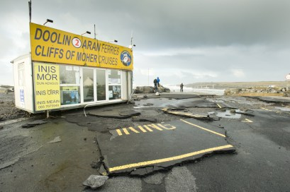 No Parking at Doolin Pier: The road adjacent to Doolin pier with a series of craters following the storm. Photograph by John Kelly.
