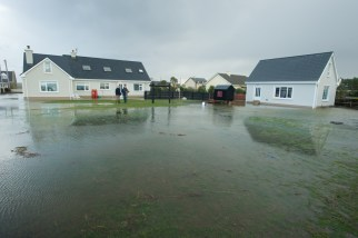 Flooding outside a family home in Seafield, Quilty. Photograph by John Kelly.