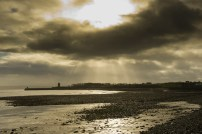 A view of Carrigaholt pier and Castle under storm clouds. Photograph by John Kelly.