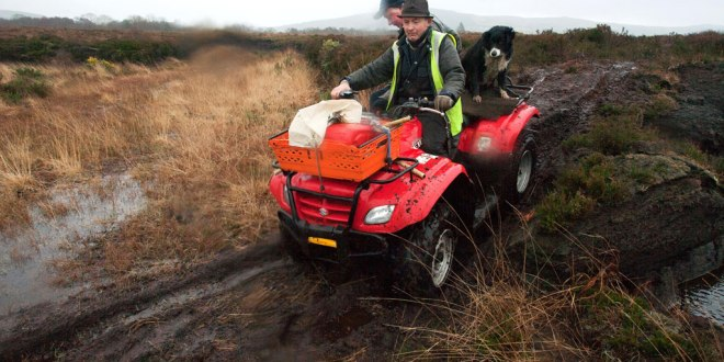 Ger Mulqueen (front) and James Peppard use the only means available to access their home through dangerous bogland. Ger's 88-year-old mother is stranded in her home.
