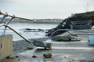 A view of the destruction to the new railing and wall following the latest high seas and gales at the West End car park in Kilkee. Photograph by John Kelly.