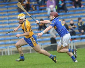 Conor Mc Grath of Clare  scores his third goal despite Paddy Stapleton of Tipperary during their National League game at Thurles. Photograph by John Kelly.
