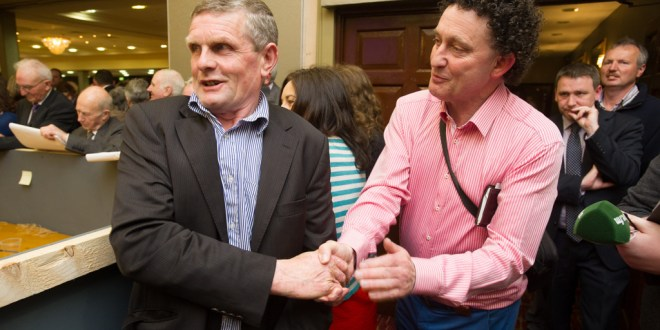 Poll topper in Killaloe area Joe Cooney is congratulated by fellow Fine Gael candidate Johnny Flynn during the election count at The West county Hotel, Ennis. Photograph by John Kelly.